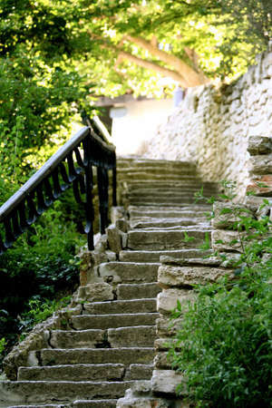 stoned: Stoned stair with ferric railing in the garden