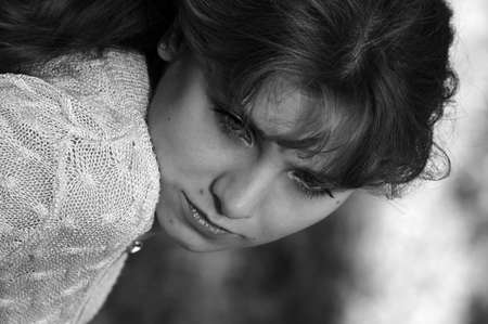 Sad thoughtful girl in black and white Stock Photo