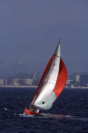 Nice red yacht sailing in the sea Stock Photo