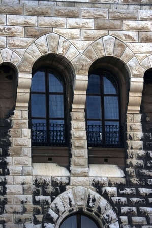Adorable windows of the medieval castle designed in the form of arch Stock Photo