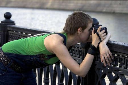 Young woman photographer making shots Stock Photo