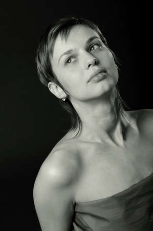 Nice portrait of dreaming woman with a smooth skin