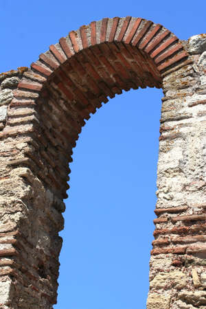 Ancient brickworked arc on the sky background