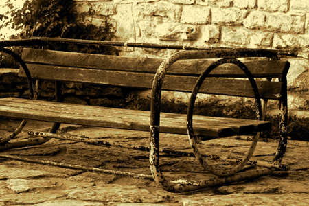 Old-fashoined bench in sepia Stock Photo