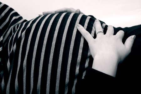Pretty tummy of a pregnant woman in black and white