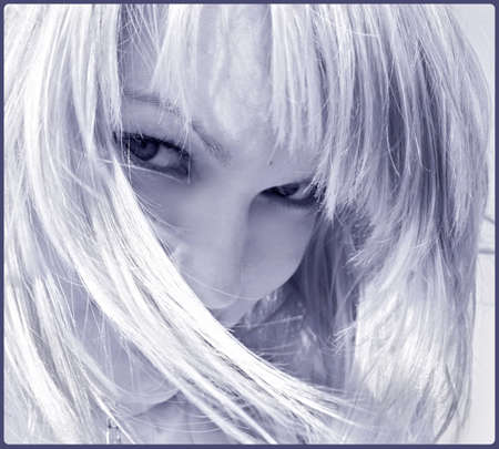 coquettish: coquettish blond woman looking straight in monochrome