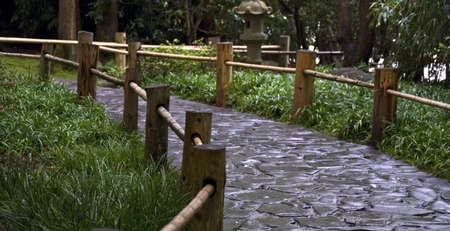 Stoned road with the wooden fence in a japanese garden