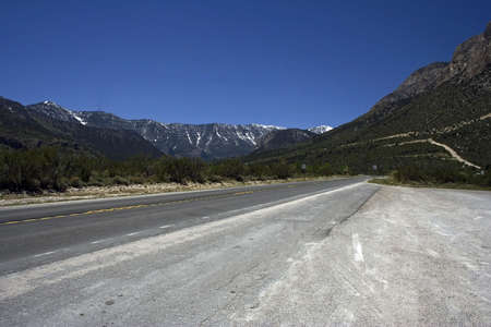 Romantic picture of an empty freeway with the mountains on a horizon
