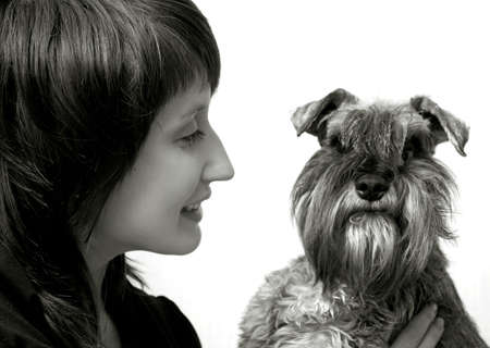 Happy owner with her pet schnauzer isolated on white