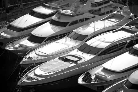 Several cutters in bay in monochrome