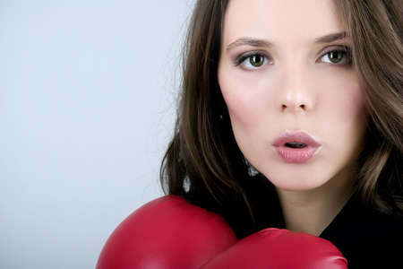 Pretty bussiness boxing woman with red gloves photo