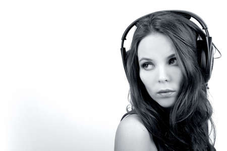 Young dj girl with headphones on white background in monochrome