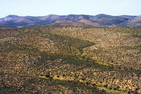lifeless: Almost lifeless desert among the mountains Stock Photo