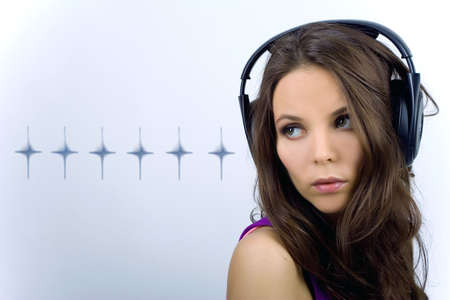 Young dj girl in club clothes with headphones on background with stars