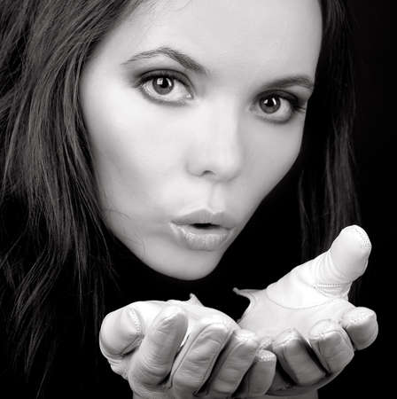 Charming blowing woman in white gloves in monochrome