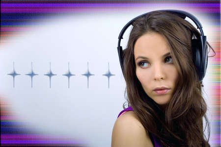Young dj girl in club clothes with headphones on bright background photo