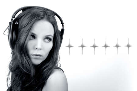 Young dj girl with headphones on satrs background in monochrome