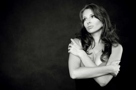 Young pretty doubtful woman Stock Photo