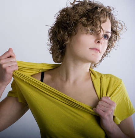 Passionate girl with curly hair in yellow dress Stock Photo