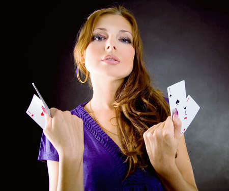 four of a kind: Young woman with aces four of a kind playing poker