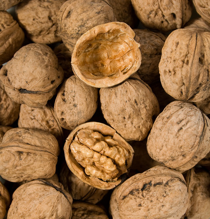 halved: One halved walnut amid others whole nuts