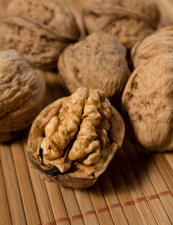 bisected: Halved walnut with other walnuts in background