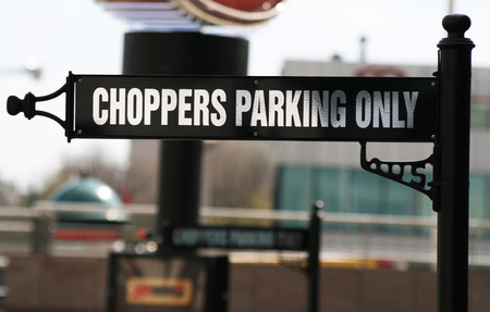 hard rock cafe: Choppers parking only sign in front of Hard Rock Cafe, Warsaw, Poland