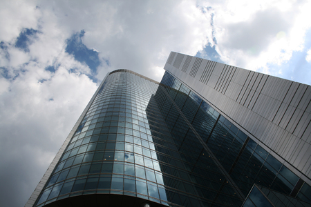raiser: Office building against cloudy sky, Warsaw, Poland Editorial
