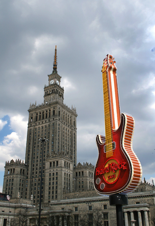 western culture: Hard Rock Cafe guitar as symbol of western culture and Palace of Culture and Science as symbol of communism era, city center of Warsaw, Poland Editorial