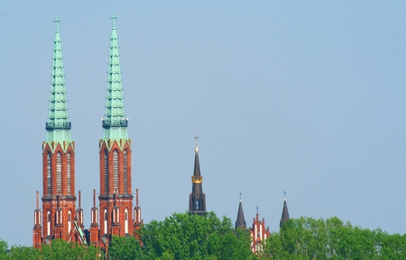 praga: Towers of churches located in Praga district in Warsaw seen from left bank of vistula river.