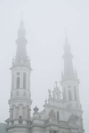 holiest: Belfries of the monumental Church of the Holiest Saviour in Warsaw , Poland, wreathed in mist Stock Photo