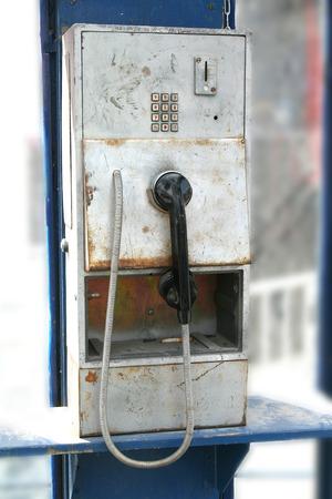 wornout: Old worn public phone in telephone box, souvenir of the communism era in Poland Stock Photo