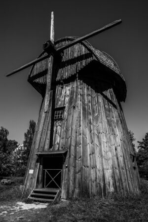 Lublin, Poland, august 2018: Old wooden windmill in Open Air Village Museum, monochrome