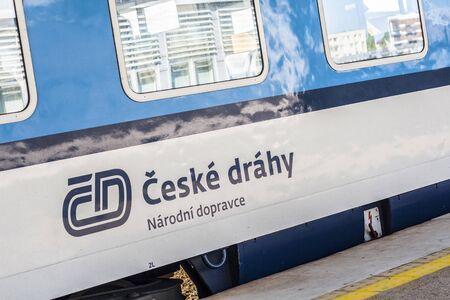 Blue and white train passenger car of Czech Republic Railway Ceske Drahy standing at platform