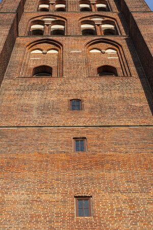 Bell Tower of gothic Basilica of the Assumption of the Blessed Virgin Mary seen from the front bottom up, Gdansk, Poland, Europe 版權商用圖片