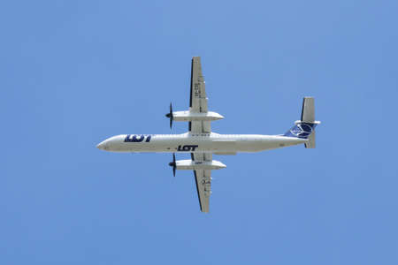 Polish airlines LOT turboprop Bombardier DHC-8-400 on the climbout after take-off from Warsaw Chopin Airport