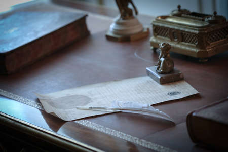 Very old letter written with feather on the antique desk Stock fotó