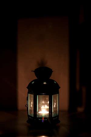 Aluminum lantern tea light candle holder lights and cast shadow