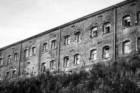 Red brick barracks building within the Modlin Fortress is one of the longest buildings in Europe, black and white image