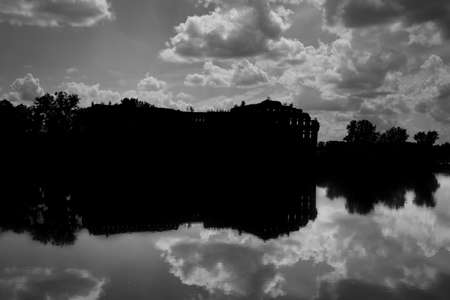 Silhouette of ruins of XIX century granary on the Narew river burned during bombing at the beginning of second world war, black and white image