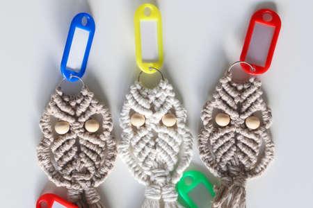 Three unique macrame hand woven owl key rings