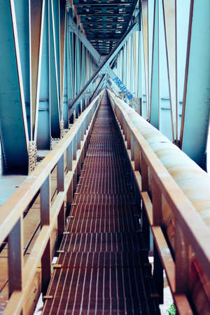 Perspective of technician catwalk and steel structural elements of railway bridge in warsaw Zdjęcie Seryjne