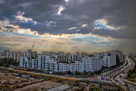 Stormy clouds in late afternoon over housing blocks of Warsaw residential area