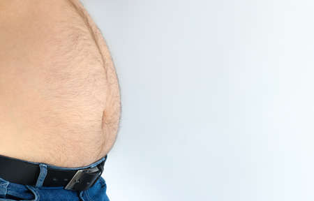 Naked fat belly of fourty years old man in jeans