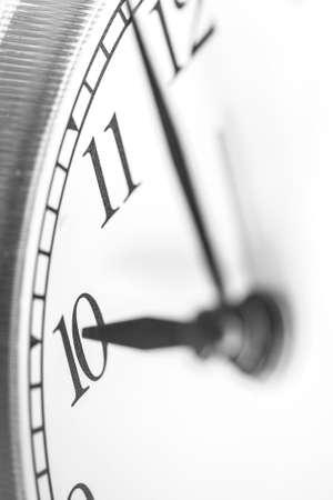 Clock hand pointing ten o'clock on white clock face of Twin bell classic alarm clock Standard-Bild