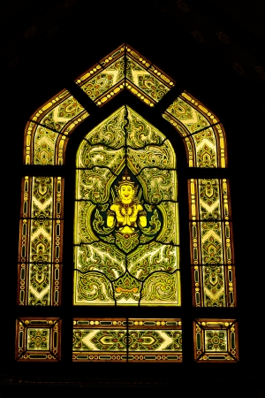 Traditional Thai style stained glass window in wat Benchama, Bangkok, Thailand