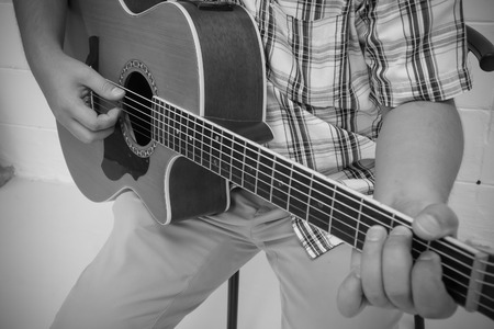 A Man play the guitar