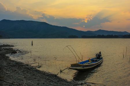 wooden boat at the lake