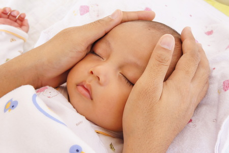 Baby sleeping and father hand Stock Photo