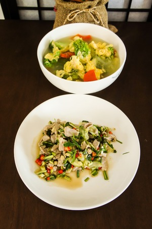seasoned: Boiled Pork with Lime Garlic and Chili Sauce, Thai and Asian style mildly seasoned soup